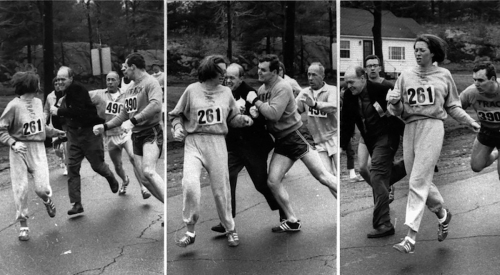 Katherine Switzer of Syracuse, found herself about to be thrown out of the normally all-male Boston Marathon when a husky companion, Thomas Miller of Syracuse, threw a block that tossed a race official out of the running instead, April 19, 1967 in Hopkinton, Mass.(AP PHOTO)
